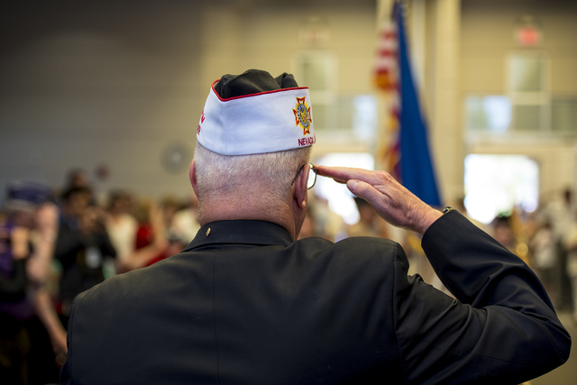 Bob Garlow salutes during the Memorial Day celebration at the Southern Nevada Veterans Memorial Cemetery in Boulder City, Nev. on Monday, May 25, 2015. (Joshua Dahl/Las Vegas Review-Journal)