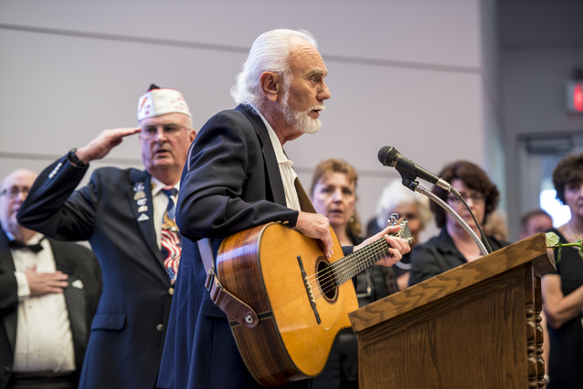 Phil Esser performs the National Anthem during the Memorial Day celebration at the Southern Nevada Veterans Memorial Cemetery in Boulder City, Nev. on Monday, May 25, 2015. (Joshua Dahl/Las Vegas  ...