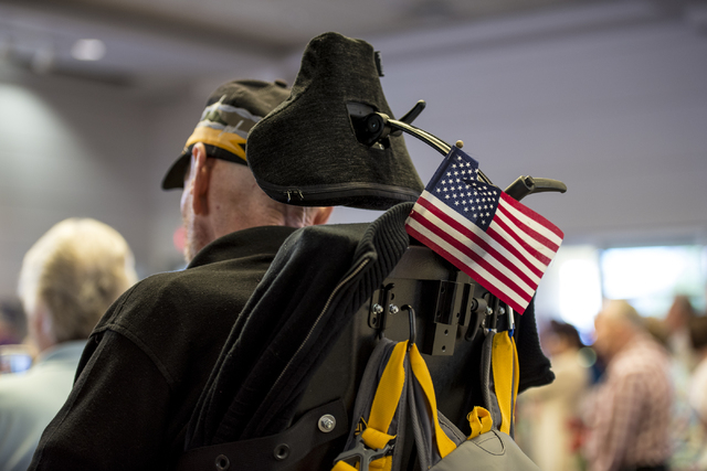 A flag hangs from a veterans wheel chair during the Memorial Day celebration at the Southern Nevada Veterans Memorial Cemetery in Boulder City, Nev. on Monday, May 25, 2015. (Joshua Dahl/Las Vegas ...