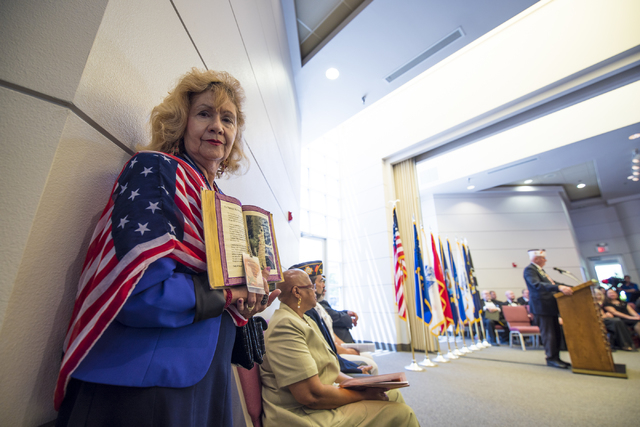 Cathy Navin pays respects during the Memorial Day celebration at the Southern Nevada Veterans Memorial Cemetery in Boulder City, Nev. on Monday, May 25, 2015. (Joshua Dahl/Las Vegas Review-Journal)