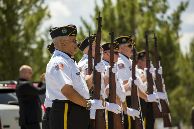 The Firing Honor Gaurd stands at attention after the 21 Gun Salute during the Memorial Day celebration at the Southern Nevada Veterans Memorial Cemetery in Boulder City, Nev. on Monday, May 25, 20 ...