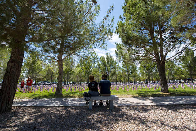 Bella Tan and Jon Perez sit on a bench during the Memorial Day celebration at the Southern Nevada Veterans Memorial Cemetery in Boulder City, Nev. on Monday, May 25, 2015. (Joshua Dahl/Las Vegas R ...