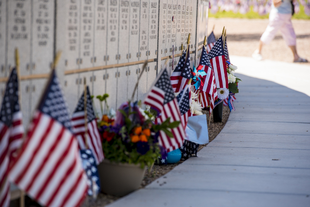 Gifts and flowers are left at the memorial during the Memorial Day celebration at the Southern Nevada Veterans Memorial Cemetery in Boulder City, Nev. on Monday, May 25, 2015. (Joshua Dahl/Las Veg ...