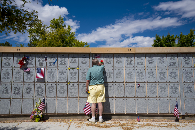 John Niles visits the memorial of his wife, Caroline, during the Memorial Day celebration at the Southern Nevada Veterans Memorial Cemetery in Boulder City, Nev. on Monday, May 25, 2015. (Joshua D ...