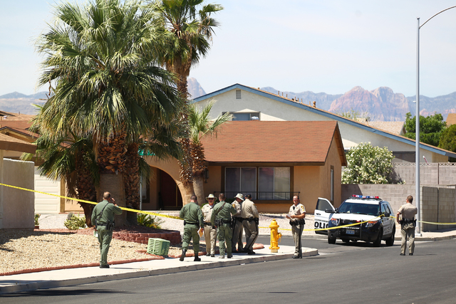 Las Vegas police investigate an officer-involved shooting on the 6300 block of Blue Jay Way, near Oakey and Jones boulevards in Las Vegas on  Wednesday, April 29, 2015, 2015. Police were respondin ...