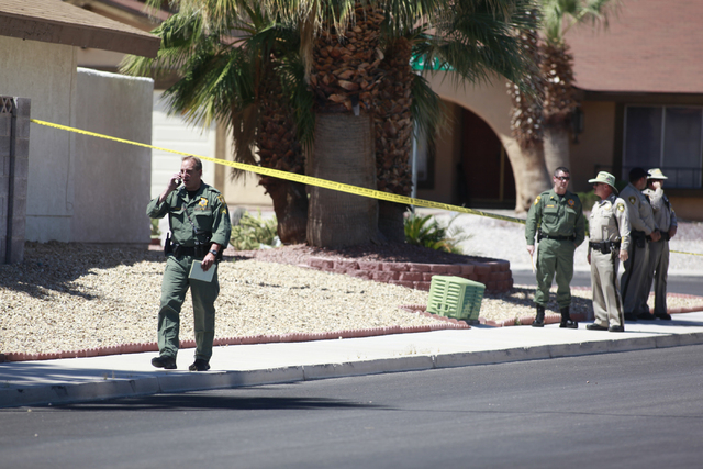 Las Vegas police investigate an officer-involved shooting on the 6300 block of Blue Jay Way, near Oakey and Jones boulevards in Las Vegas on Wednesday, April 29, 2015. Police were responding to an ...