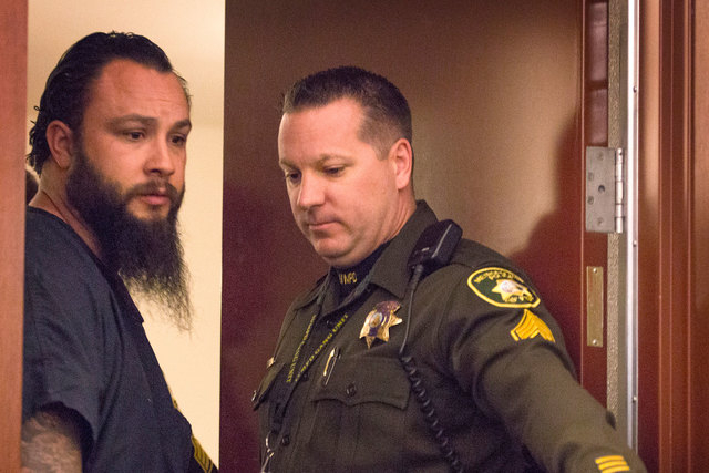 Michael Kitchen, left, the Metro detective facing several charges, makes his initial court appearance Jan. 27, 2015, in Las Vegas Justice Court. (Jeff Scheid/Las Vegas Review-Journal)