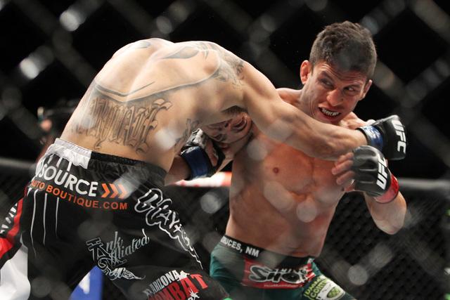 Joseph Benavidez hitsJohn Moraga during their fight at UFC 187 Saturday, May 23, 2015, at the MGM Grand Garden Arena. Benevidez won by unanimous decision. (Sam Morris/Las Vegas Review-Journal) Fol ...
