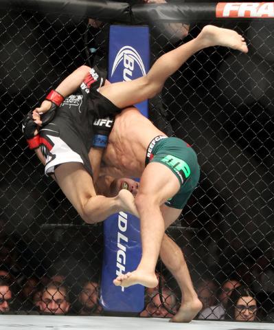 Joseph Benavidez throws John Moraga during their fight at UFC 187 Saturday, May 23, 2015, at the MGM Grand Garden Arena. Benevidez won by unanimous decision. (Sam Morris/Las Vegas Review-Journal)  ...