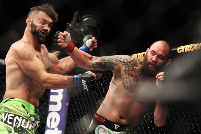 Andrei Arlovski gets hit by a right from Travis Browne during their fight at UFC 187 Saturday, May 23, 2015, at the MGM Grand Garden Arena. Arlovski won by TKO in the first round. (Sam Morris/Las  ...
