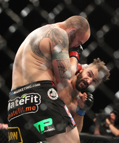 Andrei Arlovski hits Travis Browne with a right during their fight at UFC 187 Saturday, May 23, 2015, at the MGM Grand Garden Arena. Arlovski won by TKO in the first round. (Sam Morris/Las Vegas R ...