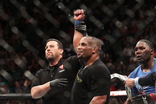 Daniel Cormier has his arm raised after defeating Anthony Johnson in their light heavyweight title fight at UFC 187 Saturday, May 23, 2015, at the MGM Grand Garden Arena. Cormier won the belt via  ...