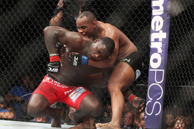 Daniel Cormier works to get position on Anthony Johnson during their light heavyweight title fight at UFC 187 Saturday, May 23, 2015, at the MGM Grand Garden Arena. Cormier won the belt via submis ...