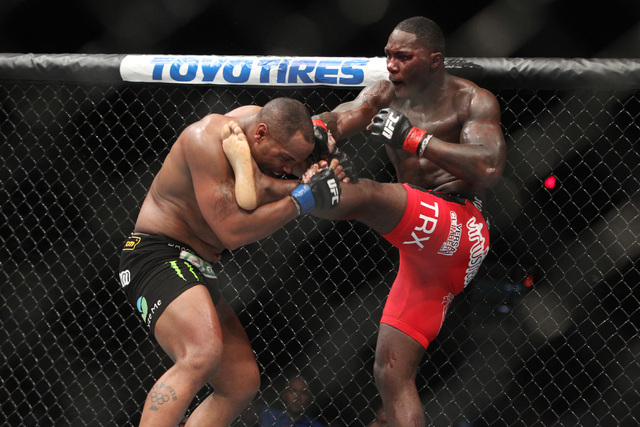 Daniel Cormier grabs the leg of Anthony Johnson during their light heavyweight title fight at UFC 187 Saturday, May 23, 2015, at the MGM Grand Garden Arena. Cormier won the belt via submission in  ...