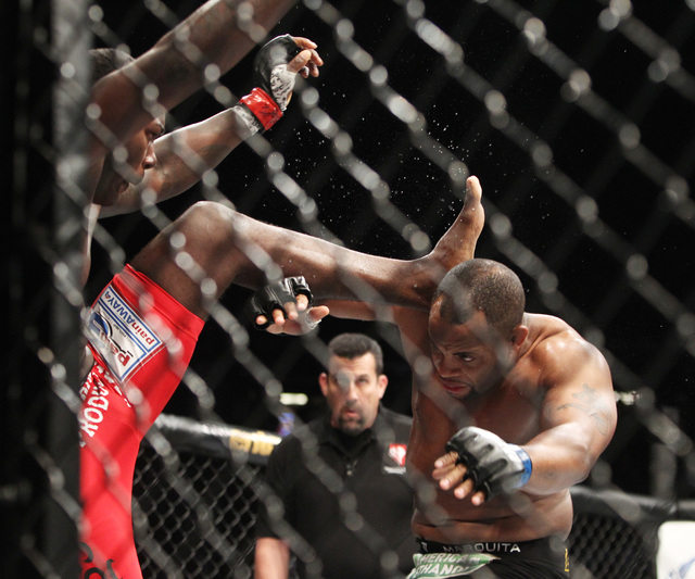 Daniel Cormier ducks a kick from Anthony Johnson during their light heavyweight title fight at UFC 187 Saturday, May 23, 2015, at the MGM Grand Garden Arena. Cormier won the belt via submission in ...