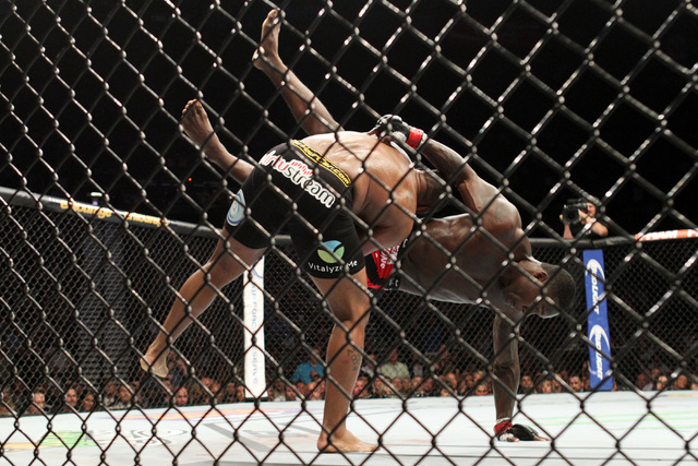 Daniel Cormier throws Anthony Johnson during their light heavyweight title fight at UFC 187 Saturday, May 23, 2015, at the MGM Grand Garden Arena. Cormier won the belt via submission in the third  ...
