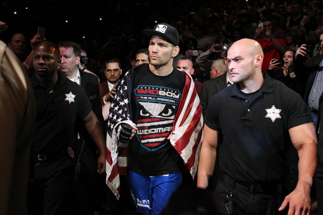 Chris Weidman makes his entrance for his middleweight title fight against Vitor Belfort at UFC 187 Saturday, May 23, 2015, at the MGM Grand Garden Arena. Weidman retained his title with a first ro ...