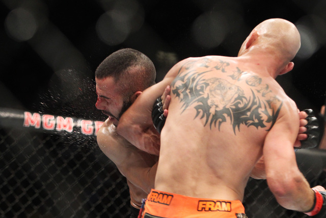 Donald Cerrone hits John Makdessi with an elbow during their fight at UFC 187 Saturday, May 23, 2015, at the MGM Grand Garden Arena. Cerrone won by TKO in the second round. (Sam Morris/Las Vegas R ...