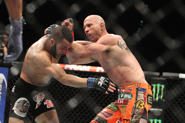 Donald Cerrone, right, and John Makdessi trade blows during their fight at UFC 187 Saturday, May 23, 2015, at the MGM Grand Garden Arena. Cerrone won by TKO in the second round. (Sam Morris/Las Ve ...