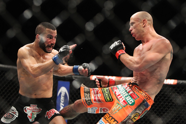 Donald Cerrone lands a kick to the leg of John Makdessi during their fight at UFC 187 Saturday, May 23, 2015, at the MGM Grand Garden Arena. Cerrone won by TKO in the second round. (Sam Morris/Las ...