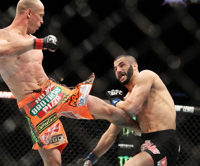 Donald Cerrone lands a kick to the body of John Makdessi during their fight at UFC 187 Saturday, May 23, 2015, at the MGM Grand Garden Arena. Cerrone won by TKO in the second round. (Sam Morris/La ...