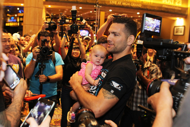 Chris Weidman holds Alexis Kemp during the media work out for UFC 187 Wednesday, May 20, 2015 at the MGM. (Sam Morris/Las Vegas Review-Journal) Follow Sam Morris on Twitter @sammorrisRJ