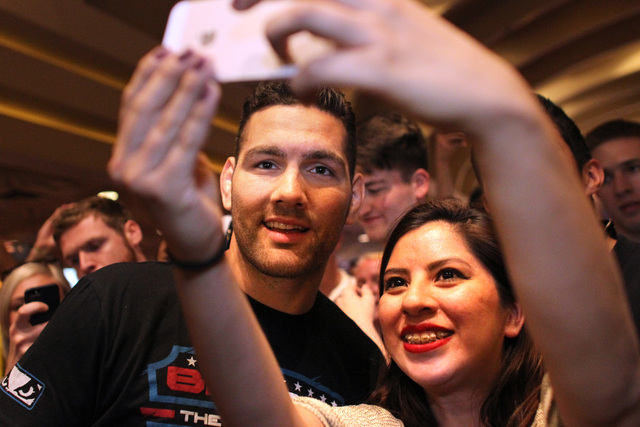 Chris Weidman takes a photo with Thalia Rojano during the media work out for UFC 187 Wednesday, May 20, 2015 at the MGM. (Sam Morris/Las Vegas Review-Journal) Follow Sam Morris on Twitter @sammorrisRJ