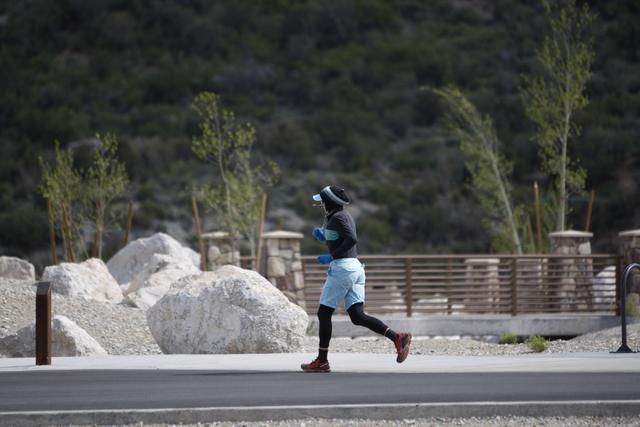 A runner dashes down the parking lot at the Spring Mountains Visitor Gateway on Kyle Canyon Road in Las Vegas on Wednesday, May 27, 2015. (Erik Verduzco/Las Vegas Review-Journal) Follow Erik Verdu ...