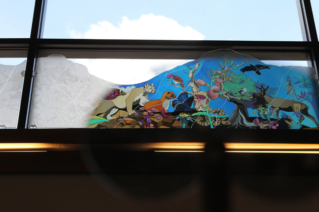 Art paintings viewed in polarized glass created by Austine Wood Comarow decorate the windows of the visitor center at the Spring Mountains Visitor Gateway on Kyle Canyon Road in Las Vegas on Wedne ...