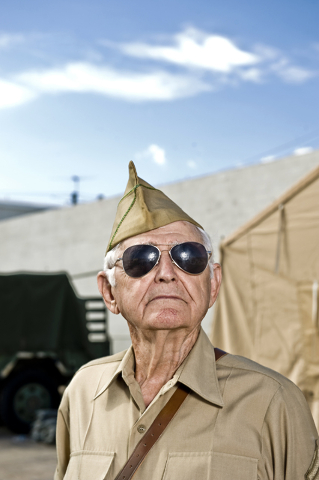 World War II veteran Gene Stephens, 94, wears his Military Police Corps uniform as he poses at Battlefield Vegas, a military theme park on Industrial Road near Circus Circus Drive in Las Vegas, Fr ...
