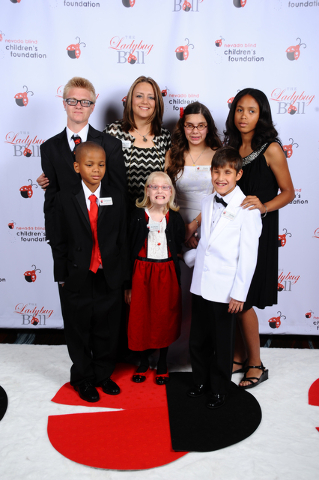 Executive Director, Emily Smith poses with Nevada Blind Children's Foundation participants at the sixth Annual Ladybug Ball on May 2, 2015. Back Row Left to Right: Taylor Allison, Emily Smith, C ...