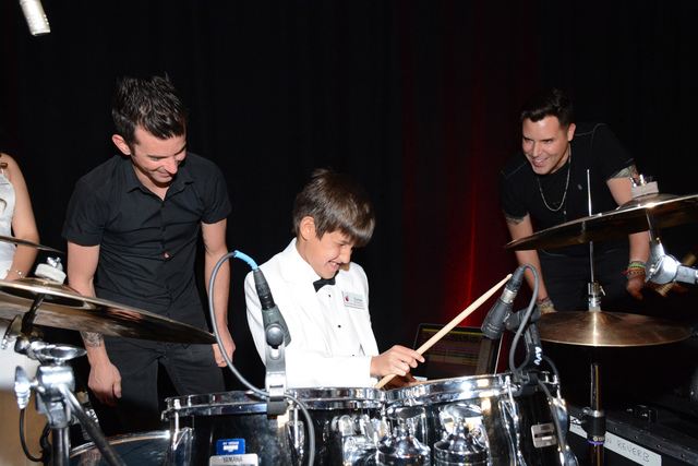 Nevada Blind Children's Foundation participant Dylan Diaz rocks out on the drums with headliner Frankie Moreno and Peanut Butter during the sixth Annual Ladybug Ball May 2, 2015. (Special to View)