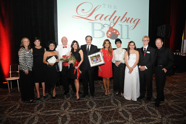 Karen & Morgan Cashman of Cashman Photo Enterprises were honored during the Nevada Blind Children's Foundation's sixth Annual Ladybug Ball on May 2, 2015. Left to Right: Emily Smith, Peggy Sel ...