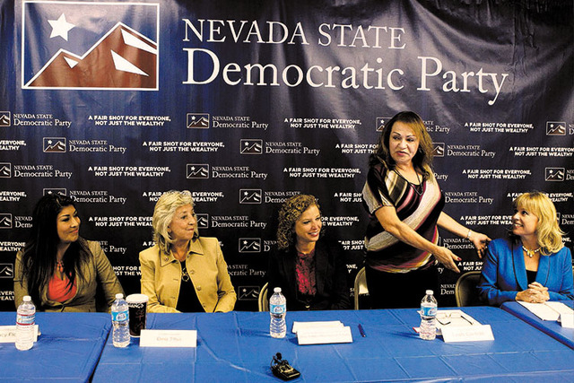 Assemblywoman Lucy Flores, left, U.S. Rep. Dina Titus, D-Nev., U.S. Rep. Debbie Wasserman Schultz, D-Fla., Linda Cavazos, vice chairwoman at the Nevada State Democratic Party, and Erin Billbray, c ...