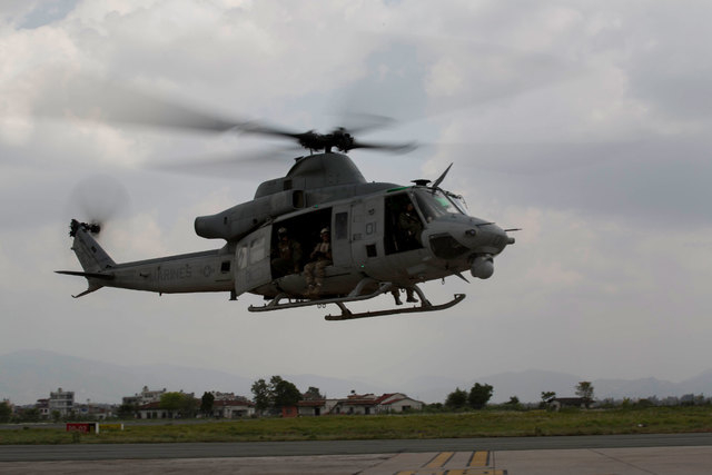 A UH-1Y Huey helicopter flies into the Tribhuvan International Airport after a search-and-rescue operation in Kathmandu, Nepal, May 13, 2015. (Reuters/Thor J. Larson/U.S. Marine Corps/Handout)