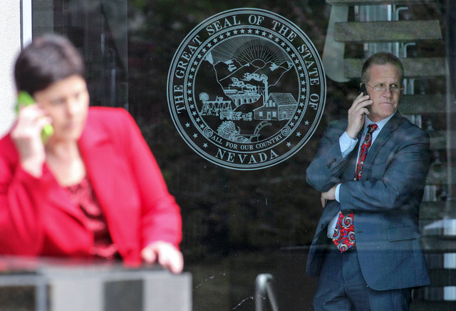 Lt. Gov. Mark Hutchison looks out the front window of the Legislative Building in Carson City, Nev., on Friday, May 22, 2015. State tax director Deonne Contine is at left. (Cathleen Allison/Las Ve ...