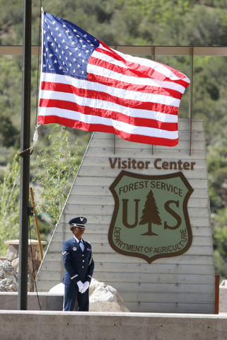 Senior Airman Alyssa Wilson, with the Nellis Air Force Base Honor Guard, stands guard at the entrance to the visitor center at Spring Mountains Visitor Gateway Friday, May 30, 2015, in Kyle Canyon ...