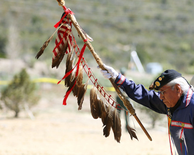 Dalton Tom, of the Southern Paiute Veterans Association, takes part in a color guard presentation during a grand opening ceremony at Spring Mountains Visitor Gateway Friday, May 30, 2015, in Kyle  ...