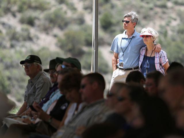 Kyril Plaskon, right center, and Sandy Bovee, right, stand and watch a grand opening ceremony at Spring Mountains Visitor Gateway Friday, May 30, 2015, in Kyle Canyon near Las Vegas. The new 128-a ...