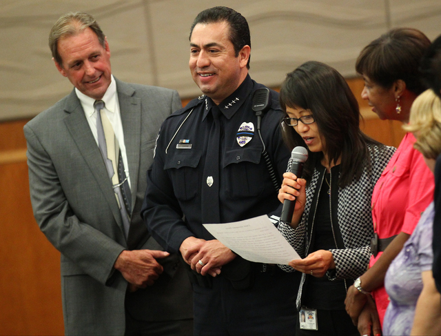 North Las Vegas City Manager Qiong Liu, third from left, speaks during the swearing-in ceremony for new police chief Alex Perez, second from left, at a city council meeting at North Las Vegas City ...