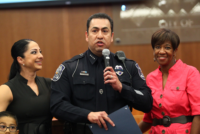 North Las Vegas Police Chief Alex Perez, center, speaks during his swearing-in ceremony as his wife Karina, left, and Councilwoman Pamela Goynes-Brown look on at a city council meeting at North La ...