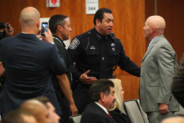 North Las Vegas Police Chief Alex Perez, center, greets belief before his swearing-in ceremony at a city council meeting at North Las Vegas City Hall on Wednesday, May 20, 2015. (Chase Stevens/Las ...