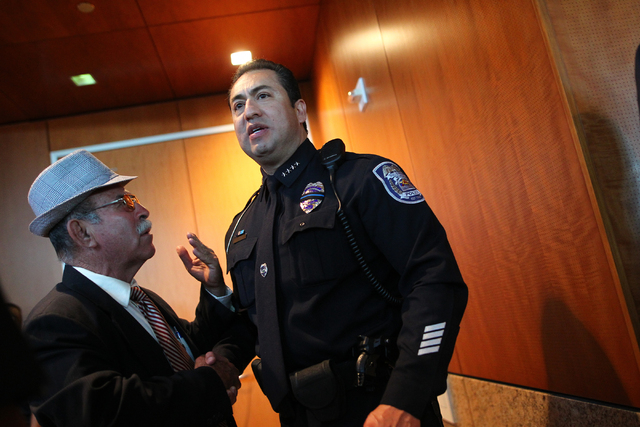 North Las Vegas Police Chief Alex Perez, right, greets supporters following his swearing-in ceremony at a city council meeting at North Las Vegas City Hall on Wednesday, May 20, 2015. (Chase Steve ...