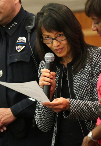 North Las Vegas City Manager Qiong Liu speaks during the swearing-in ceremony for new police chief Alex Perez, not pictured, at a city council meeting at North Las Vegas City Hall on Wednesday, Ma ...