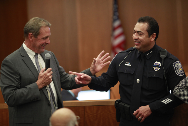 North Las Vegas Mayor John Lee, left, speaks during the swearing-in ceremony for new police chief Alex Perez, right, at a city council meeting at North Las Vegas City Hall on Wednesday, May 20, 20 ...