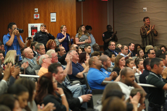 People clap during the swearing-in ceremony for new police chief Alex Perez, not pictured, at a city council meeting at North Las Vegas City Hall on Wednesday, May 20, 2015. (Chase Stevens/Las Veg ...
