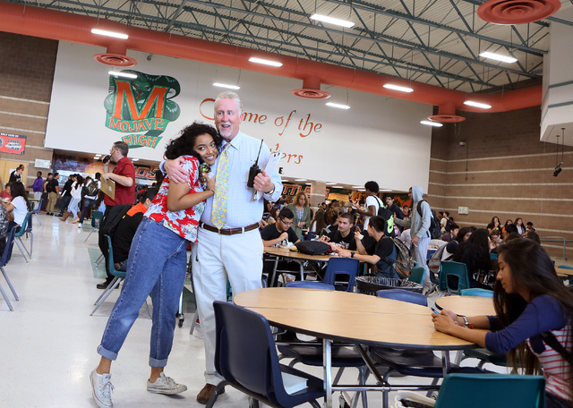 Assistant Principal Steve Slocum, center, receives a hug from student Michelle Jesse, during a lunch period at Mojave High School May 18, 2015, in North Las Vegas. (Ronda Churchill/View)