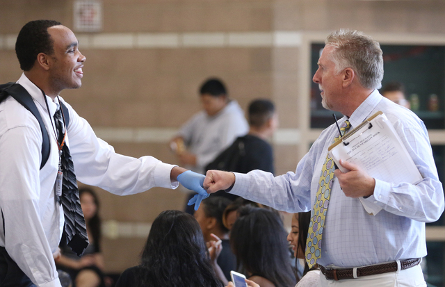 Assistant Principal Steve Slocum, right, bumps fists with student Latrail Smith during a lunch period at Mojave High School May 18, 2015, in North Las Vegas. (Ronda Churchill/View)