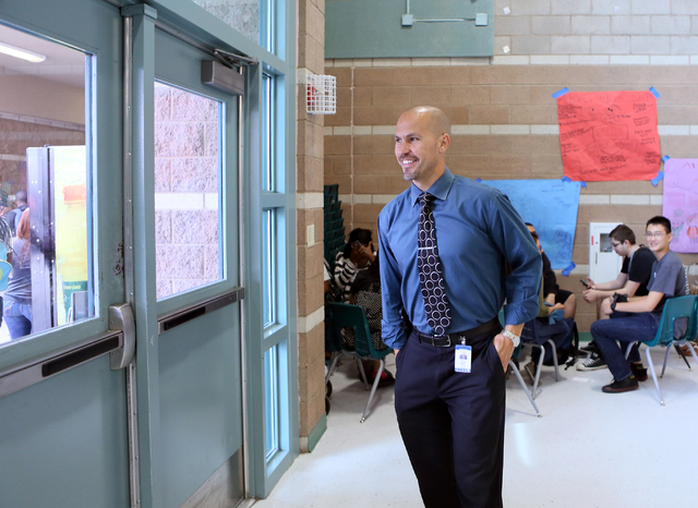 Principal Antonio Rael smiles as he walks away from a group of students he was speaking to while supervising a lunch period at Mojave High School May 18, 2015, in North Las Vegas. (Ronda Churchill ...