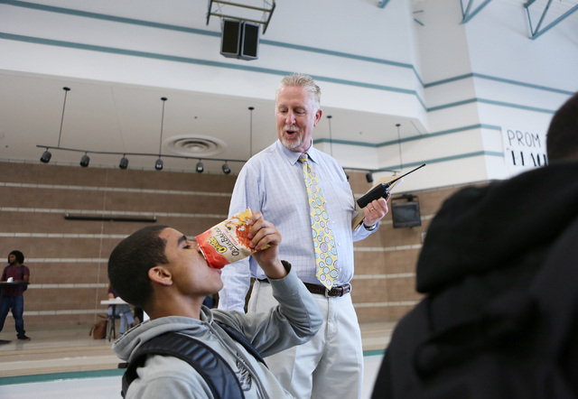 Assistant Principal Steve Slocum, center, jokes with Daryl Adams, left, while supervising a lunch period at Mojave High School May 18, 2015, in North Las Vegas. School administrators are developin ...